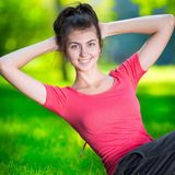 Woman doing exercises for abdominal muscles royalty free stock images