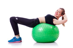 Woman doing exercises with ball Royalty Free Stock Photography