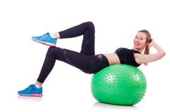 Woman doing exercises with ball Royalty Free Stock Images