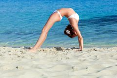 A woman is doing exercises on the beach Royalty Free Stock Image