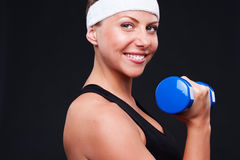 Woman doing exercises for biceps Royalty Free Stock Images