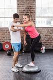 Woman doing exercises on a bossu ball. In crossfit gym Stock Photos