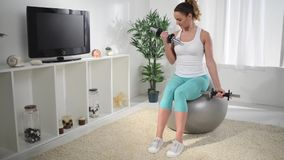 Woman Doing Exercises With Dumbbell stock footage