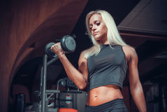 Woman doing exercises with dumbbell in the gym Royalty Free Stock Photos