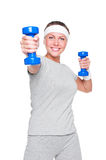 Woman doing exercises with dumbbells Stock Photo