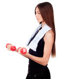 Woman doing exercises with dumbbells red Stock Photo