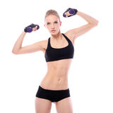 Woman doing exercises with dumbells. Beautiful woman doing exercises with dumbells over white background Royalty Free Stock Image