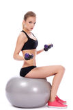 Woman doing exercises with dumbells Royalty Free Stock Photography