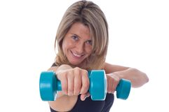 Woman doing exercises with dumbels Stock Photo