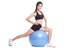 Woman doing exercises with fitness ball Royalty Free Stock Photos