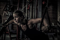 Woman doing exercises in the gym Stock Photos