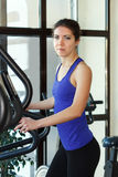 Woman doing exercises in gym Stock Images