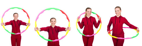 The woman doing exercises with hula hoop Royalty Free Stock Photo