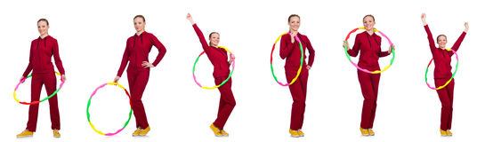 The woman doing exercises with hula hoop Stock Photo
