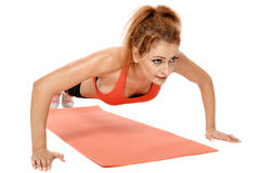 Woman doing exercises on a mat Royalty Free Stock Photography