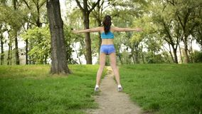 Woman Doing Exercises In The Park stock video footage