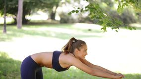 Woman Doing Exercises In The Park stock footage