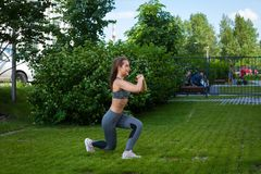 Woman doing exercises in the park stock images