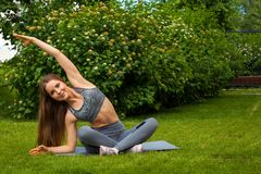 Woman doing exercises in the park stock photos