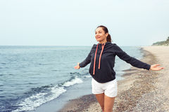 Woman doing exercises at sea Royalty Free Stock Image