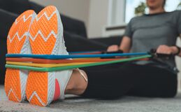 Free Woman Doing Exercises With Resistance Bands Royalty Free Stock Images - 190539299