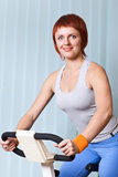 Woman doing exercising on training apparatus Stock Photos
