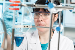 Woman doing experiment Stock Photography