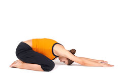 Woman Doing Extended Child Pose Yoga Asana. Fit woman doing yoga exercise called extended child's pose, sanskrit name: Utthita Balasana, isolated over white Stock Image