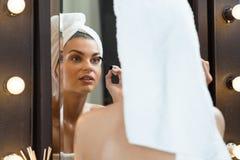 Woman doing eye make-up Royalty Free Stock Image