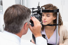 Woman doing eye test with optometrist royalty free stock image