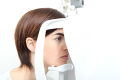 Woman doing eyesight measurement with optical lamp. Woman doing eyesight measurement with optical slit lamp stock photography