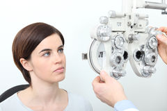 Woman doing eyesight measurement with optical slit lamp Royalty Free Stock Photography