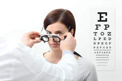 Woman doing eyesight measurement with trial frame Stock Image