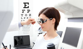 Woman doing eyesight measurement with trial frame and visual test Stock Image