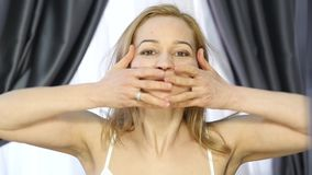 Woman doing face fitness, aging chang in the muscles of the face. strengthening of the upper and lower eyelid.  stock video