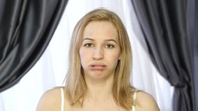 Woman doing face fitness, aging chang in the muscles of the face. strengthening of the upper and lower eyelid.  stock video footage