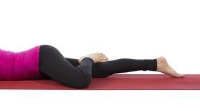 Woman doing facedown hip rotation Royalty Free Stock Photo