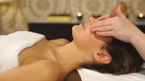 The woman doing the facial massage stock footage