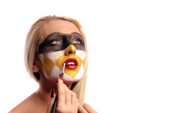 Woman doing fashion make-up Royalty Free Stock Photos