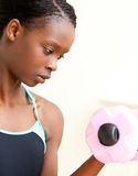 Woman doing fitness with dumbbells Royalty Free Stock Images