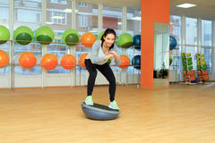 Woman doing fitness exercise with ball Stock Images