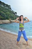 Woman doing fitness exercise on the beach Royalty Free Stock Photo