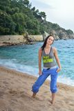 Woman doing fitness exercise on the beach Royalty Free Stock Images
