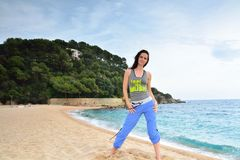 Woman doing fitness exercise on the beach Stock Images