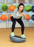 woman doing fitness exercise with bosu ball Royalty Free Stock Photos