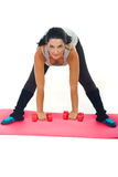 Woman doing fitness exercise with dumbbell Stock Photography