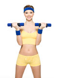 Woman doing fitness exercise with dumbbells Stock Images