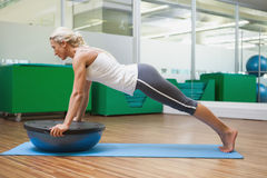 Woman doing fitness exercise in fitness studio Stock Image