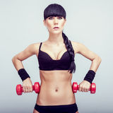 Woman doing fitness exercise with a hand weights. Stock Photo