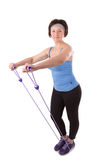 Woman doing fitness exercise. Royalty Free Stock Image